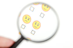 Smile face and magnifier Royalty Free Stock Photos