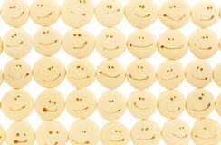 Smile face on sponge drop cookie Stock Photos