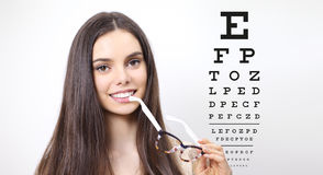 Free Smile Female Face With Spectacles On Eyesight Test Chart Stock Image - 94556631