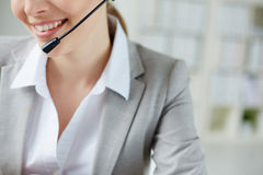 Smile of female operator Royalty Free Stock Photography