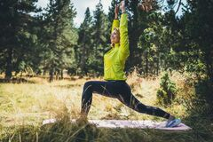 Free Smile Fitness Girl Exercising Outdoors In Park, Activity Yoga Pose With Stretch Legs, Sporty Woman Stretching Exercises Training Royalty Free Stock Images - 182889219