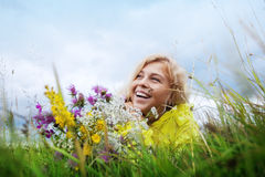 Smile and flowers Stock Photography