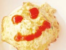 Smile fried egg. Cute smile fried egg hot food Stock Photos