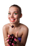 Smile funny woman eat one of two ripe cherry Stock Images