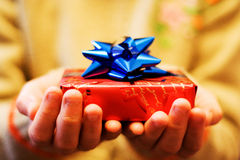 A smile for a gift. Two hands giving a gift to you Stock Photos