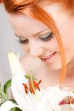 Smile of the girl. With beautiful flowers Stock Photo