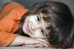 Smile of girl. European four-year-old brown-eyed smiling girl Victoria Royalty Free Stock Images