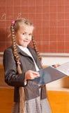 Smile girl in classroom Stock Photos