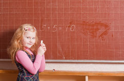 Smile girl in classroom Stock Photography