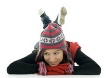Smile girl from crossed legs in winter cap Stock Photography