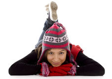 Smile girl from crossed legs in winter cap Royalty Free Stock Image