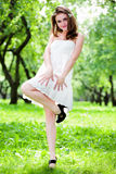 Smile girl dance in white dress Stock Image