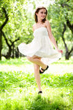 Smile girl dance in white dress Stock Images