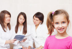Smile girl with doctors Stock Photos
