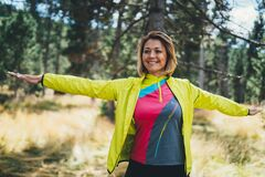 Free Smile Girl Exercising Outdoors In Green Park, Activity With Stretch Arms. Young Fitness Woman Doing Stretching Exercises Training Stock Photography - 181507252