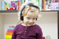 Smile girl with headset Stock Image