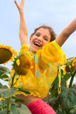 Smile Girl and sunflower Stock Image