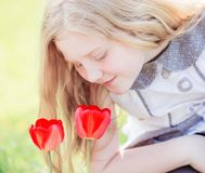 Smile girl with tulips outdoor Royalty Free Stock Photos