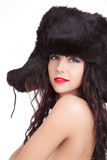 Smile girl in winter fur cap with ear-flaps Stock Image
