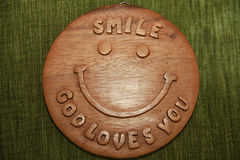 Smile, God love you text on wood Royalty Free Stock Photos