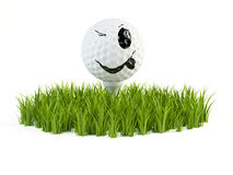 Smile golf ball on grass Royalty Free Stock Photo