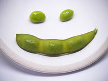 Smile green soya. On white circle background Royalty Free Stock Photo