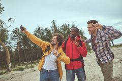 Smile guys using gadget during holiday journey royalty free stock image