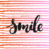 Smile - hand drawn lettering phrase, isolated on the striped background.  Stock Photo