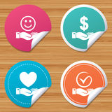 Smile and hand icon. Heart, Tick symbol. Round stickers or website banners. Smile and hand icon. Heart and Tick or Check symbol. Palm holds Dollar currency sign Stock Photos
