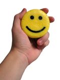 Smile in a hand over white background. F/2.2. 1/50 s royalty free stock photo