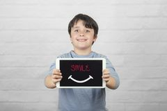 Smile, Happy child holding a tablet stock photo
