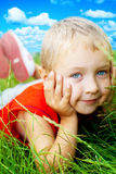 Smile of happy cute child in spring grass Stock Photos