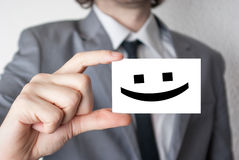 Smile happy face. Businessman in suit with a black tie showing o Stock Photo
