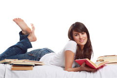 Smile and happy  surrounded by books Royalty Free Stock Photography