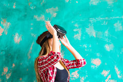 Smile happy woman getting experience using VR-headset glasses of virtual reality at home much gesticulating hands Stock Images