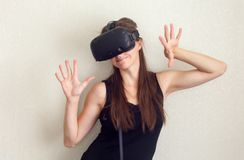 Smile happy woman getting experience using VR-headset glasses of virtual reality at home much gesticulating hands, beauty. royalty free stock photo