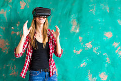 Smile happy woman getting experience using VR-headset glasses of virtual reality much gesticulating hands Royalty Free Stock Images