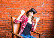 Smile happy woman getting experience using VR-headset glasses of virtual reality much gesticulating hands Stock Image