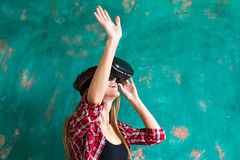 Smile happy woman getting experience using VR-headset glasses of virtual reality much gesticulating hands Royalty Free Stock Photo