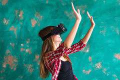 Smile happy woman getting experience using VR-headset glasses of virtual reality much gesticulating hands Royalty Free Stock Image