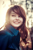 Smile happy young girl outdoor sunlight portrait. Soft light vintage effect street photoshoot Royalty Free Stock Photography