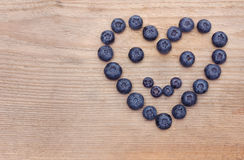 Smile heart of bilberries Stock Photos