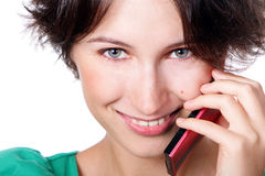 Smile hello. A smiling girl speaks by a mobile phone Stock Image