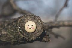 Smile icon miniature on tree Stock Photos