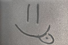 Smile image on the freezen window. Picture on the Iced water drop. Black white background stock image