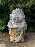 Smile Japanese Buddha Statue with Large Bead Necklace and Broom Stock Images