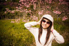 Smile lady with Pink cherry flower Royalty Free Stock Images