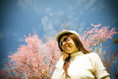 Smile lady with pink cherry flower and blue sky. 2 Royalty Free Stock Photography