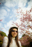 Smile lady with Pink cherry flower tree. 2 Stock Photos