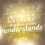 Smile is a language that even a baby understands Stock Photo